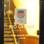 Image of Rio Grande Restaurant door with trivia bowl sign