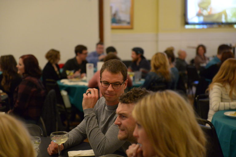 Image of group of people talking at table