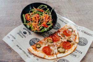 Image of Pizza and Salad from Pizza Rev