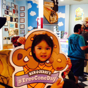 Image of little kid in cut out free cone day